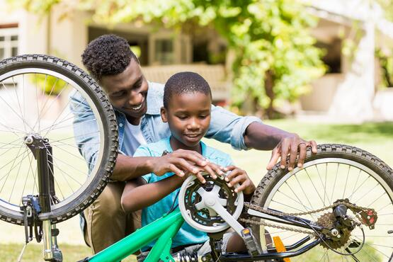 Father and son fixing bike 2-min